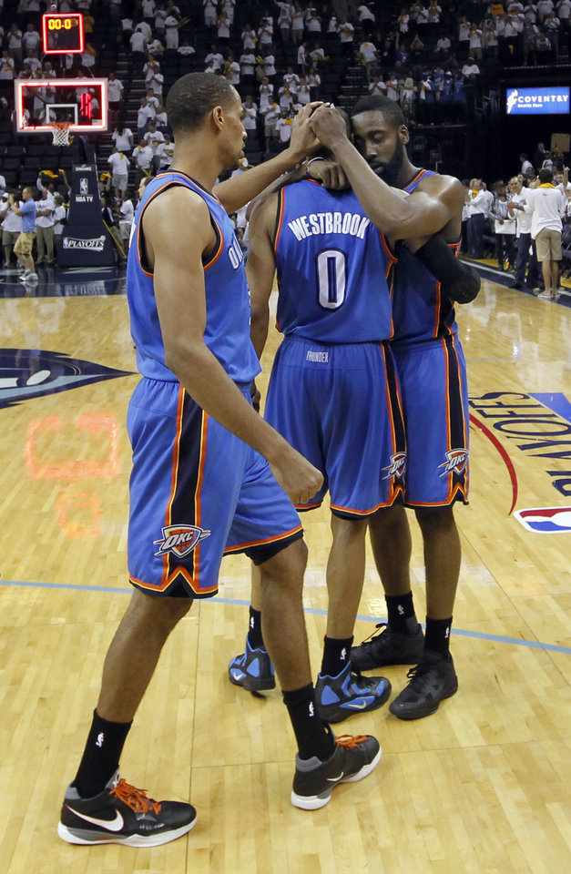 Photo - Oklahoma City Thunder guard Thabo Sefolosha, of Switzerland, left, guard Russell Westbrook (0) and James Harden, right, celebrate after beating the Memphis Grizzlies in Game 4 of a second-round NBA basketball playoff series on Tuesday, May 10, 2011, in Memphis, Tenn. Oklahoma City won 133-123 in triple overtime. (AP Photo/Lance Murphey)