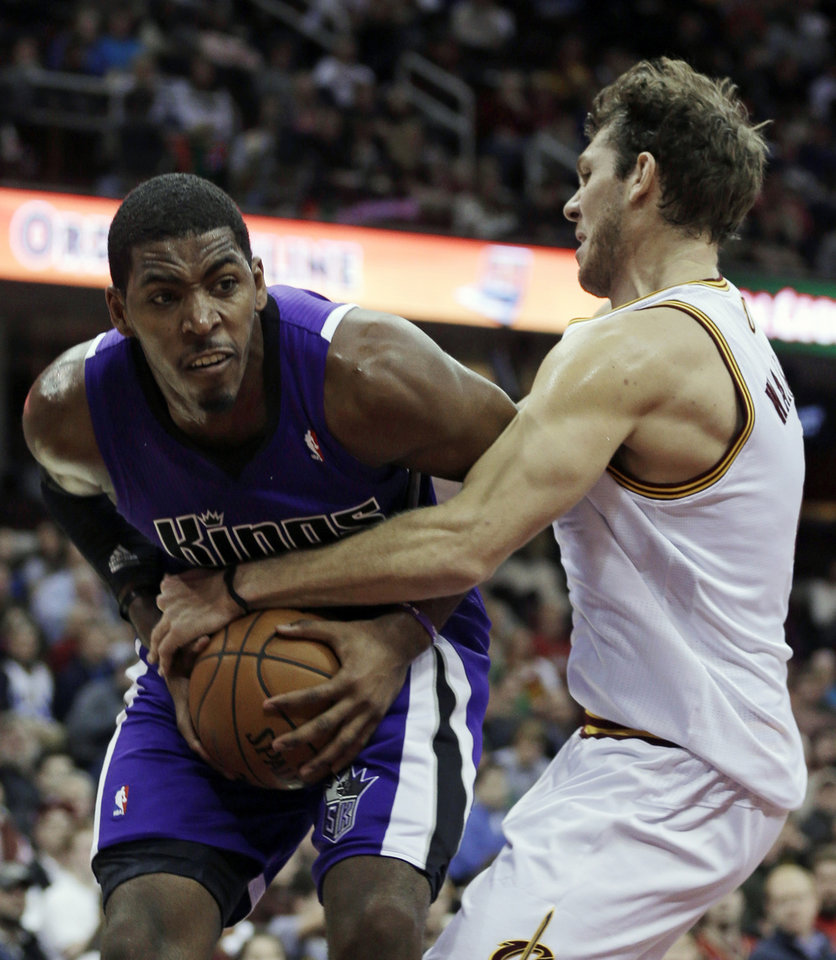 Sacramento Kings' Jason Thompson, left, is fouled by Cleveland Cavaliers' Luke Walton during the second quarter of an NBA basketball game on Wednesday, Jan. 2, 2013, in Cleveland. (AP Photo/Tony Dejak)