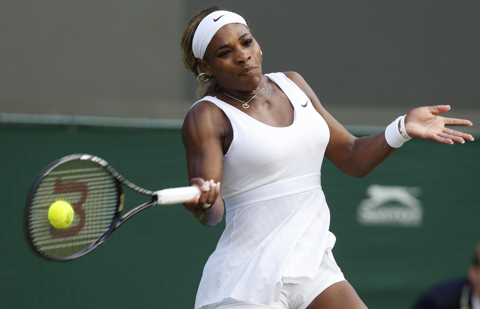 Photo - Serena Williams of U.S. plays a return to Alize Cornet of France during their women's singles match at the All England Lawn Tennis Championships in Wimbledon, London, Saturday, June 28, 2014. (AP Photo/Sang Tan)