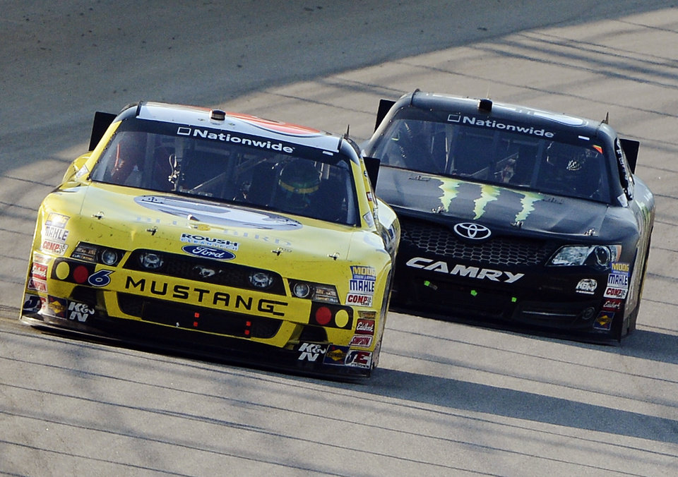 Photo -   Ricky Stenhouse Jr., (6) leads Kyle Busch (54) during the NASCAR Nationwide Series auto race at Chicagoland Speedway in Joliet, Ill., Saturday, Sept. 15, 2012. (AP Photo/Warren Wimmer)