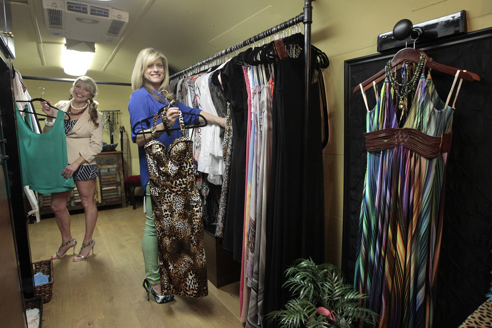 Photo - Rosie Dalton, left, and Sande Brandt check inventory in their Airstream travel trailer named Couture in a Can, March 11, 2013, in Fort Worth, Texas. (Ron T. Ennis/Fort Worth Star-Telegram/MCT)