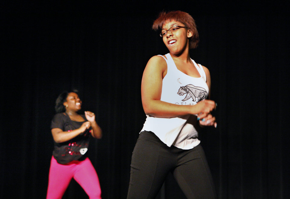 Alysse Jackson, 17, a junior at John Marshall Mid-High School, is on stage Tuesday in a dance class.