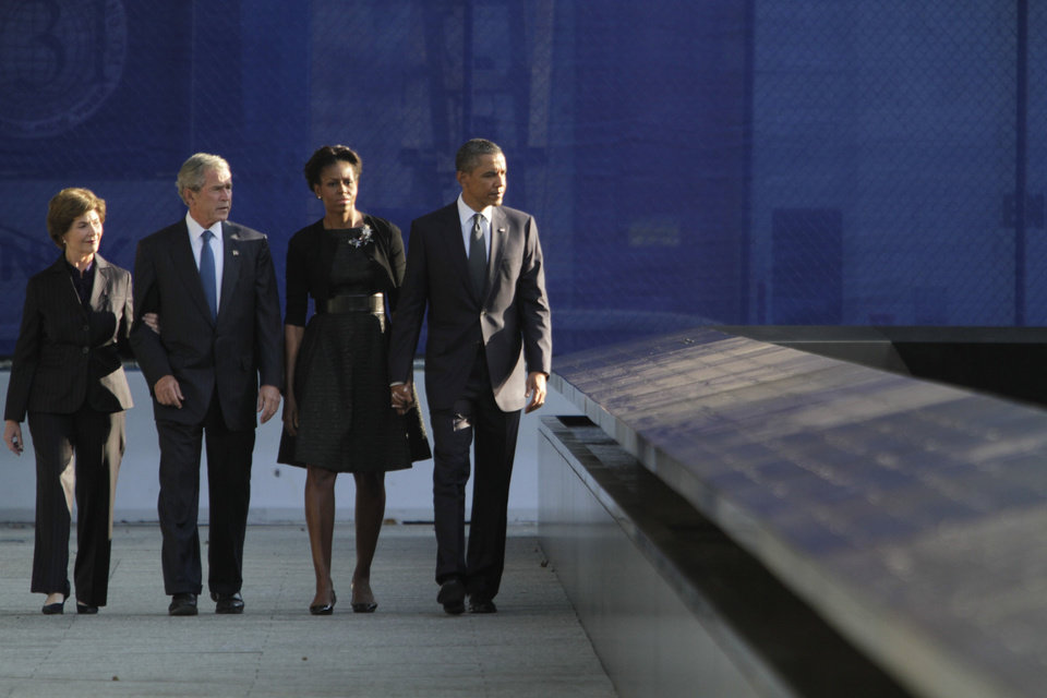 Photo -   President Barack Obama, right, first lady Michelle Obama, second from right, former President George W. Bush second from left, and former first lady Laura Bush arrive at the National September 11 Memorial for a ceremony marking the 10th anniversary of the attacks at World Trade Center, Sunday, Sept. 11, 2011 in New York. (AP Photo/Mary Altaffer)