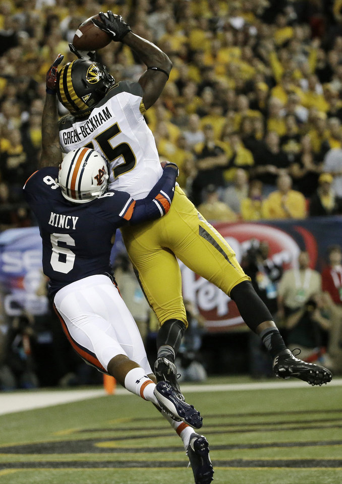 Missouri wide receiver Dorial Green-Beckham (15) makes a touch-down catch against Auburn defensive back Jonathon Mincy (6)during the first half of the Southeastern Conference NCAA football championship game, Saturday, Dec. 7, 2013, in Atlanta. (AP Photo/David Goldman)