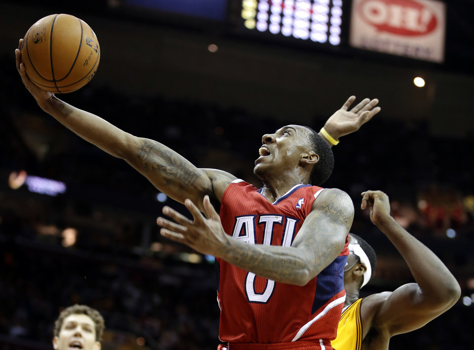 Atlanta Hawks' Jeff Teague (0) shoots inside Cleveland Cavaliers' Tristan Thompson in the first quarter of an NBA basketball game, Friday, Dec. 28, 2012, in Cleveland. (AP Photo/Mark Duncan)