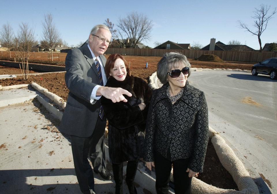 Photo - Kelly McNitt, left, one of the developers of Glenbrook Park, looks over the site in Nichols Hills with Realtors Connie Givens and Kanela Huff.  PAUL HELLSTERN - The Oklahoman