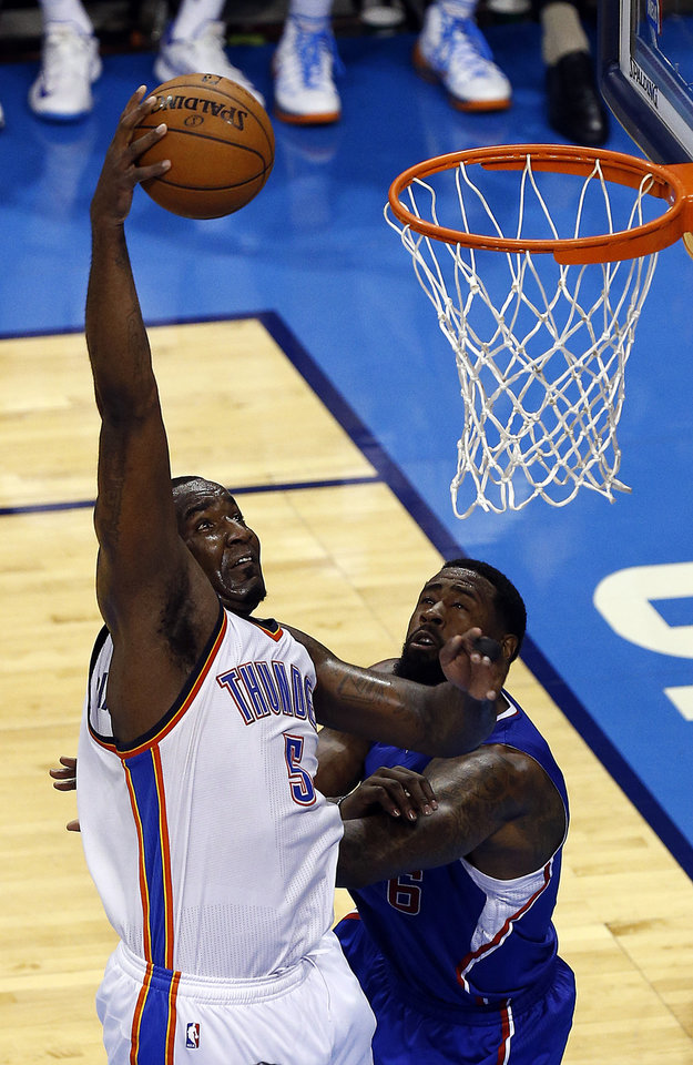 Photo - Oklahoma City's Kendrick Perkins (5) shoots over Los Angeles' DeAndre Jordan (6) during Game 2 of the Western Conference semifinals in the NBA playoffs between the Oklahoma City Thunder and the Los Angeles Clippers at Chesapeake Energy Arena in Oklahoma City, Wednesday, May 7, 2014. Photo by Sarah Phipps, The Oklahoman