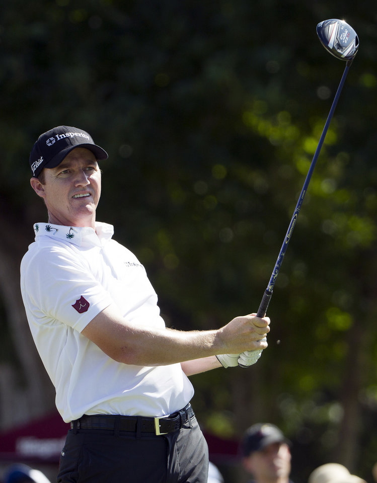 Photo - Jimmy Walker watches his drive off the first tee during the fourth round of the Sony Open golf tournament at Waialae Country Club, Sunday, Jan. 12, 2014, in Honolulu. (AP Photo/Eugene Tanner)