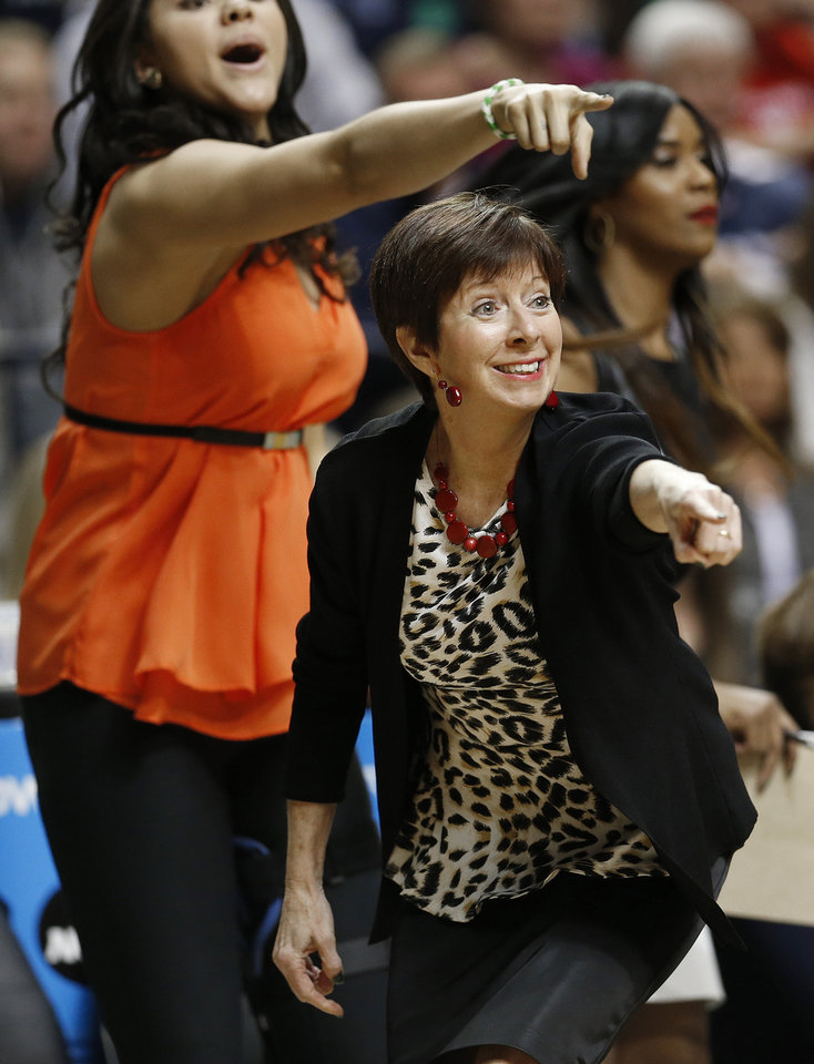 Photo - Notre Dame head coach Muffet McGraw works against Connecticut during the first half of the championship game in the Final Four of the NCAA women's college basketball tournament, Tuesday, April 8, 2014, in Nashville, Tenn. (AP Photo/Mark Humphrey)