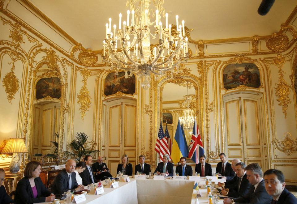 Photo - U.S. Secretary of State John Kerry, centre, hosts the Budapest Memorandum Ministerial meeting with Ukrainian Foreign Minister Andrii Deshchytsia, 3rd right, and British Foreign Secretary William Hague, 2nd left, at  U.S. ambassador's residence in Paris, Wednesday  March 5, 2014. U.S. Secretary of State John Kerry is in Paris where he is expected to hold talks with his Russian counterpart, Sergey Lavrov, about the crisis in Ukraine's Crimea Peninsula which is now controlled by Russian troops.  (AP Photo/Kevin Lamarque, Pool)