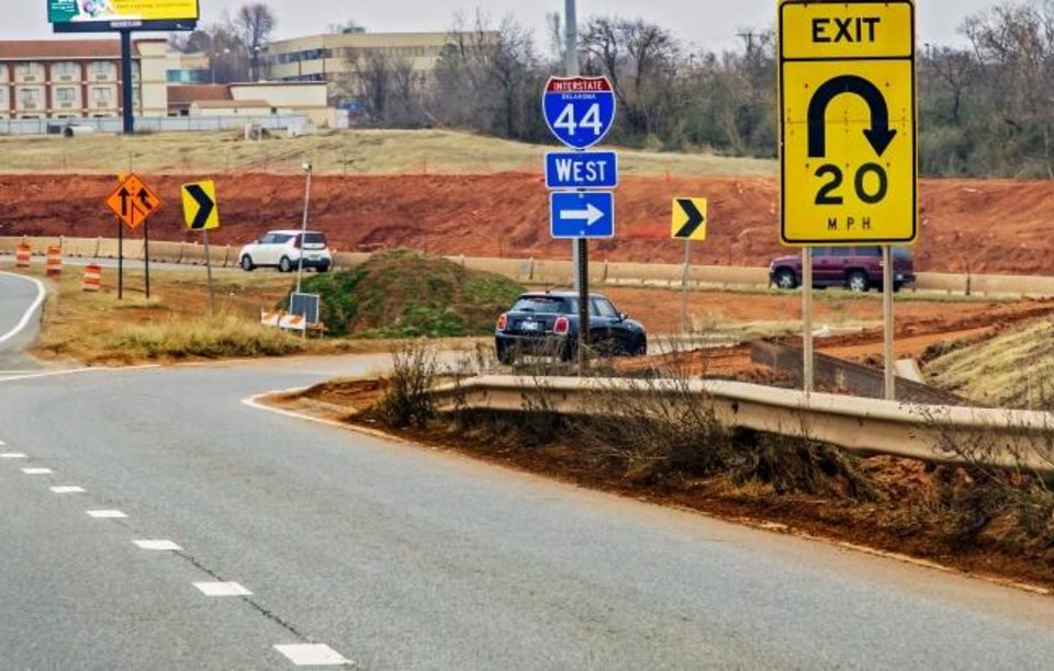Photo - The exit to go westbound on I-44 from northbound I-235 is marked with a new exit sign in Oklahoma City, Okla. on Monday, Feb. 17, 2020.   [Chris Landsberger/The Oklahoman]
