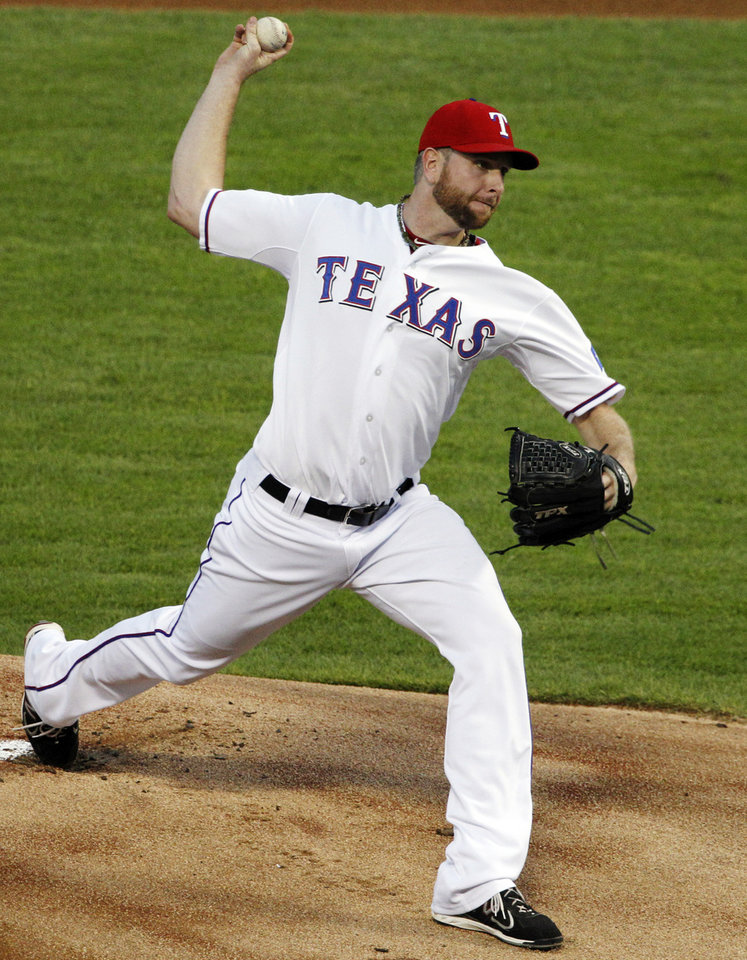 Photo -   Texas Rangers starting pitcher Scott Feldman (39) delivers to the Oakland Athletics in the first inning of a baseball game, Tuesday, Sept. 25, 2012, in Arlington, Texas. (AP Photo/Tony Gutierrez)