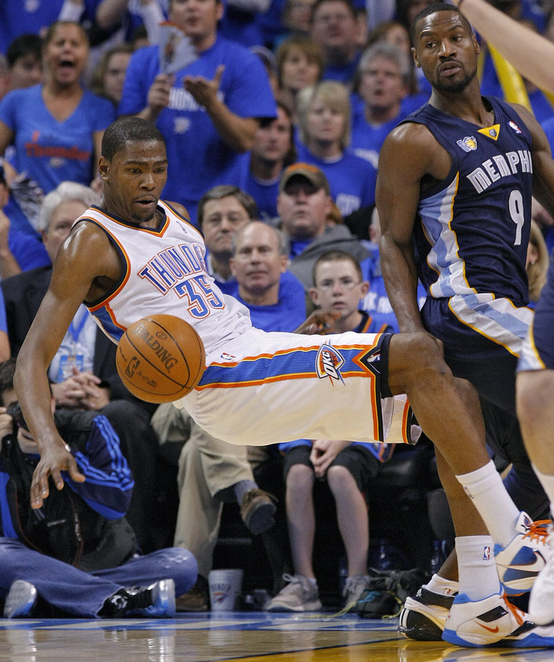 Photo - Oklahoma City's Kevin Durant (35) falls to the court while going after a rebound against Memphis' Tony Allen (9) during game one of the Western Conference semifinals between the Memphis Grizzlies and the Oklahoma City Thunder in the NBA basketball playoffs at Oklahoma City Arena in Oklahoma City, Sunday, May 1, 2011. Photo by Chris Landsberger, The Oklahoman