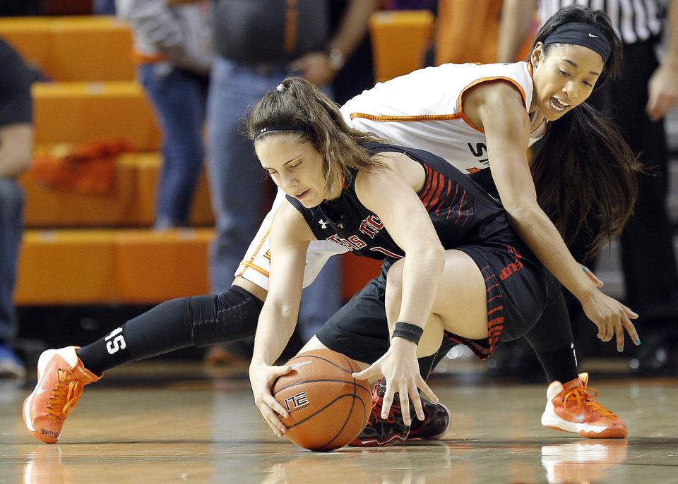 Oklahoma State's Tiffany Bias (3) and Marina Lizarazu (1) fight for a loose ball tduring the women's college basketball game between Oklahoma State and Texas Tech at  Gallagher-Iba Arena in Stillwater, Okla., , Saturday, Jan. 18, 2014.  Photo by Sarah Phipps, The Oklahoman
