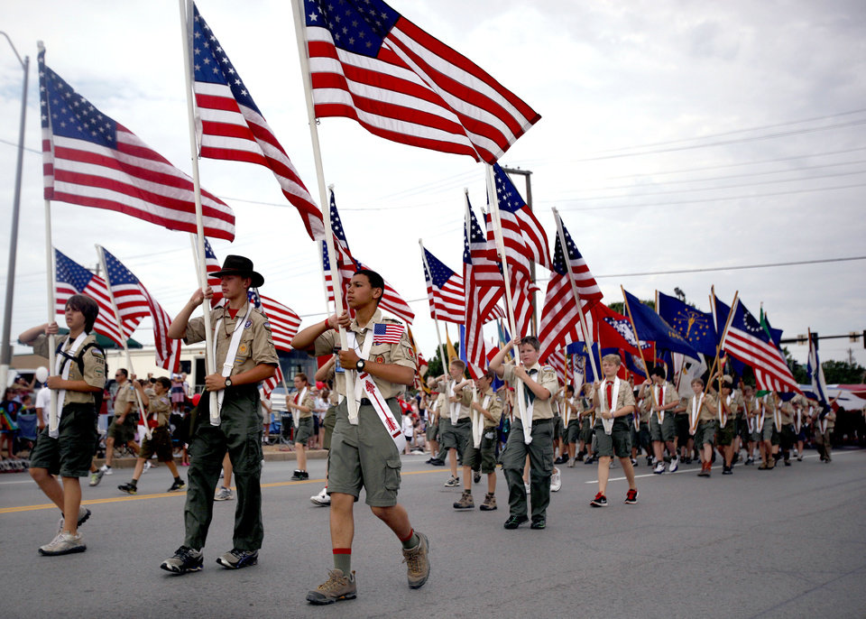 Photo - Boy Scouts of America troops carry American Flags during the LibertyFest Parade in Edmond, Okla., Monday, July 4, 2011. Photo by Sarah Phipps, The Oklahoman