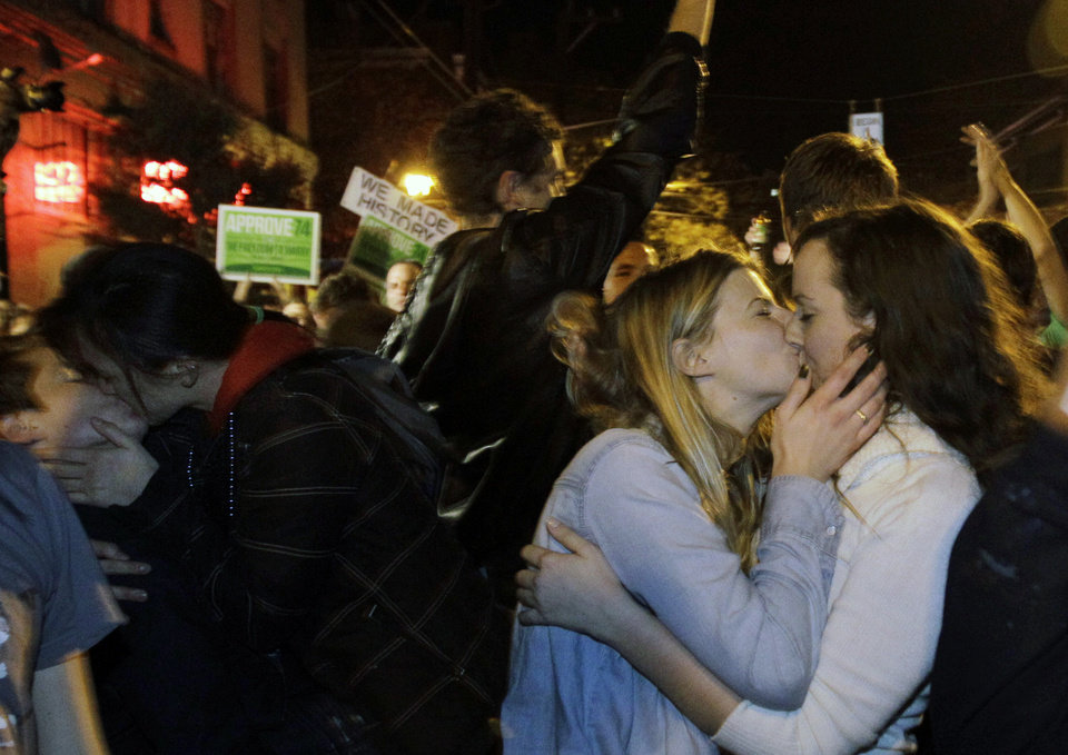 Revelers kiss as they celebrate early election returns favoring Washington state Referendum 74, which would legalize gay marriage, during a large impromptu street gathering in Seattle\'s Capitol Hill neighborhood, in the early hours of Wednesday, Nov. 7, 2012. The re-election of President Barack Obama and Referendum 74 drew the most supporters to the streets. (AP Photo/Ted S. Warren)