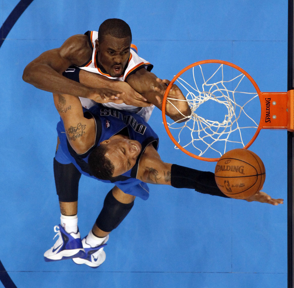 Oklahoma City\'s Serge Ibaka (9) defends Dallas\' Shawn Marion (0) during game one of the first round in the NBA playoffs between the Oklahoma City Thunder and the Dallas Mavericks at Chesapeake Energy Arena in Oklahoma City, Saturday, April 28, 2012. Oklahoma City won, 99-98. Photo by Nate Billings, The Oklahoman