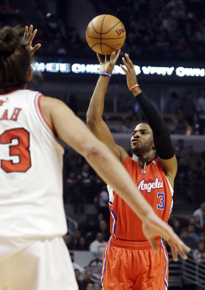 Los Angeles Clippers guard Chris Paul (3) shoots in front of Chicago Bulls center Joakim Noah during the first half of an NBA basketball game, Tuesday, Dec. 11, 2012, in Chicago. (AP Photo/Charles Rex Arbogast)