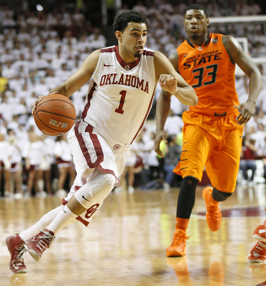 Oklahoma's Frank Booker (1) drives in front of Oklahoma State's Marcus Smart (33) in the second half during the NCAA men's Bedlam basketball game between the Oklahoma State Cowboys (OSU) and the Oklahoma Sooners (OU) at Lloyd Noble Center in Norman, Okla., Monday, Jan. 27, 2014. OU won, 88-76. Photo by Nate Billings, The Oklahoman