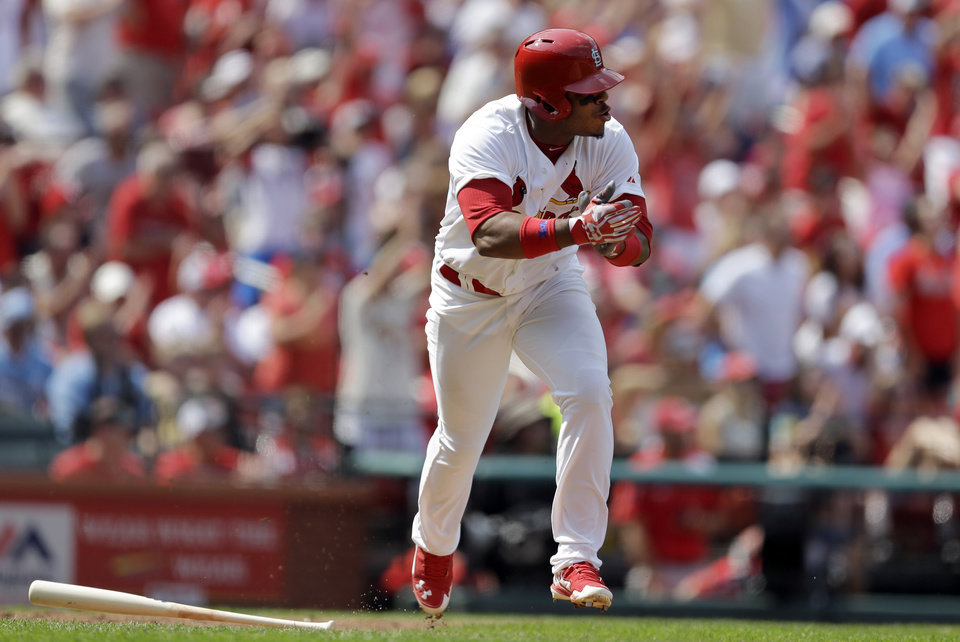 Photo - St. Louis Cardinals' Oscar Taveras applauds as he runs down the first base line after hitting an RBI single during the seventh inning of a baseball game against the Milwaukee Brewers Sunday, Aug. 3, 2014, in St. Louis. (AP Photo/Jeff Roberson)