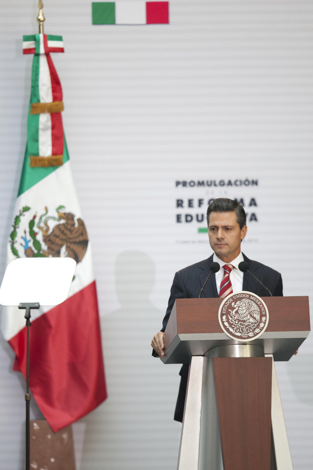 "Mexico's President Enrique Pena Nieto pauses during a speech at the National Palace where he signed into law a plan to overhaul his country's public education system, in Mexico City, Monday, Feb. 25, 2013. The law which was approved by Congress in December, calls for creation of a professional system for hiring, evaluating and promoting teachers without the ""discretionary criteria"" currently used in a system where teaching positions are often bought or inherited. (AP Photo/Alexandre Meneghini)"