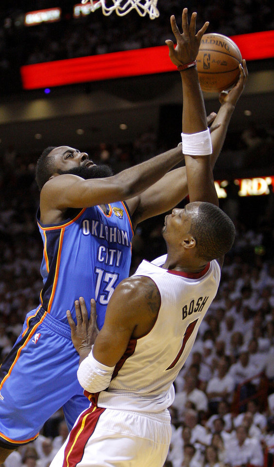 Photo - Oklahoma City's James Harden (13) runs into Miami's Chris Bosh (1) during Game 5 of the NBA Finals between the Oklahoma City Thunder and the Miami Heat at American Airlines Arena, Thursday, June 21, 2012. Photo by Bryan Terry, The Oklahoman