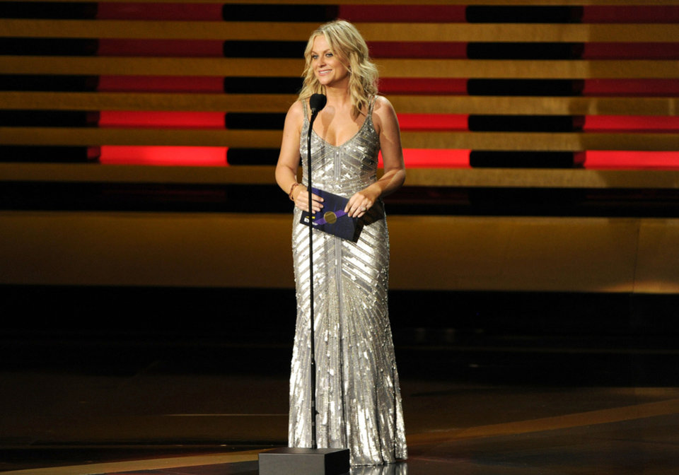 Photo - Amy Poehler presents the award for outstanding supporting actor in a comedy series on stage at the 66th Annual Primetime Emmy Awards at the Nokia Theatre L.A. Live on Monday, Aug. 25, 2014, in Los Angeles. (Photo by Chris Pizzello/Invision/AP)