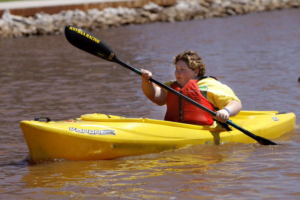 Maggie Valentine, 12, of Oklahoma City tries out a kayak during the Paddle Now! Youth Experience on the Oklahoma River, Saturday, April 21, 2012. Photo by Sarah Phipps, The Oklahoman.
