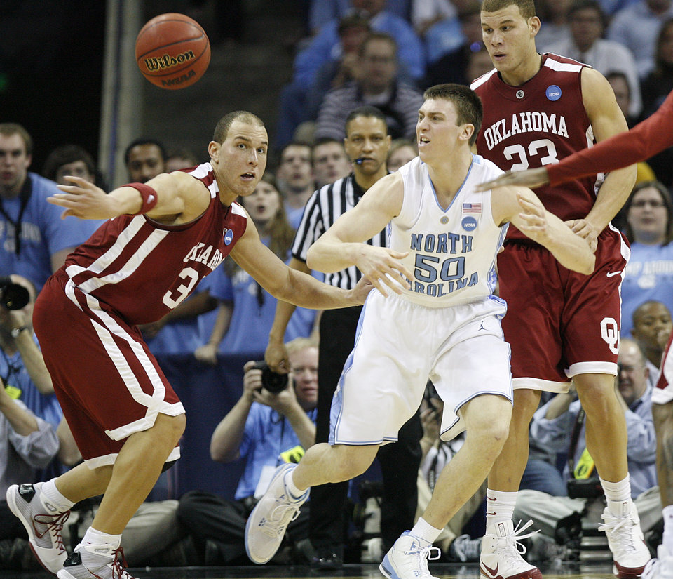 Photo - Oklahoma's Taylor Griffin (32) and Blake Griffin (23) defend on North Carolina's Tyler Hansbrough (50) during the second half in the Elite Eight game of NCAA Men's Basketball Regional between the University of North Carolina and the University of Oklahoma at the FedEx Forum on Sunday, March 29, 2009, in Memphis, Tenn.