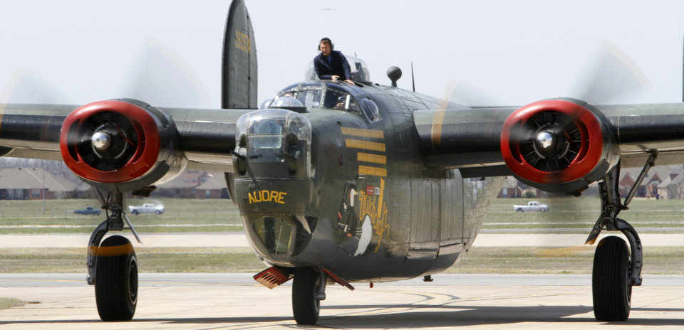 Flight engineer Rick Ziel helps bring a B-24 into Wiley Post Airport in Oklahoma City , Friday April 5, 2013. Photo By Steve Gooch, The Oklahoman