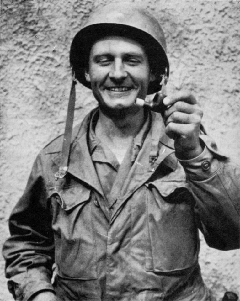 "In this undated photo provided by the Catholic Diocese of Wichita, Father Emil Kapaun holds out a broken pipe. The plain-spoken, pipe-smoking chaplain is receiving the Medal of Honor posthumously for his ""extraordinary heroism"" while serving as an Army chaplain during the Korean War. He died in captivity in 1951 _ about six months after being taken prisoner. His fellow POWs lobbied for decades to have him receive the prestigious military honor and some of them will be at the White House to see his relatives accept the medal on his behalf on April 11, 2013. (AP Photo/Courtesy Catholic Diocese of Wichita)"