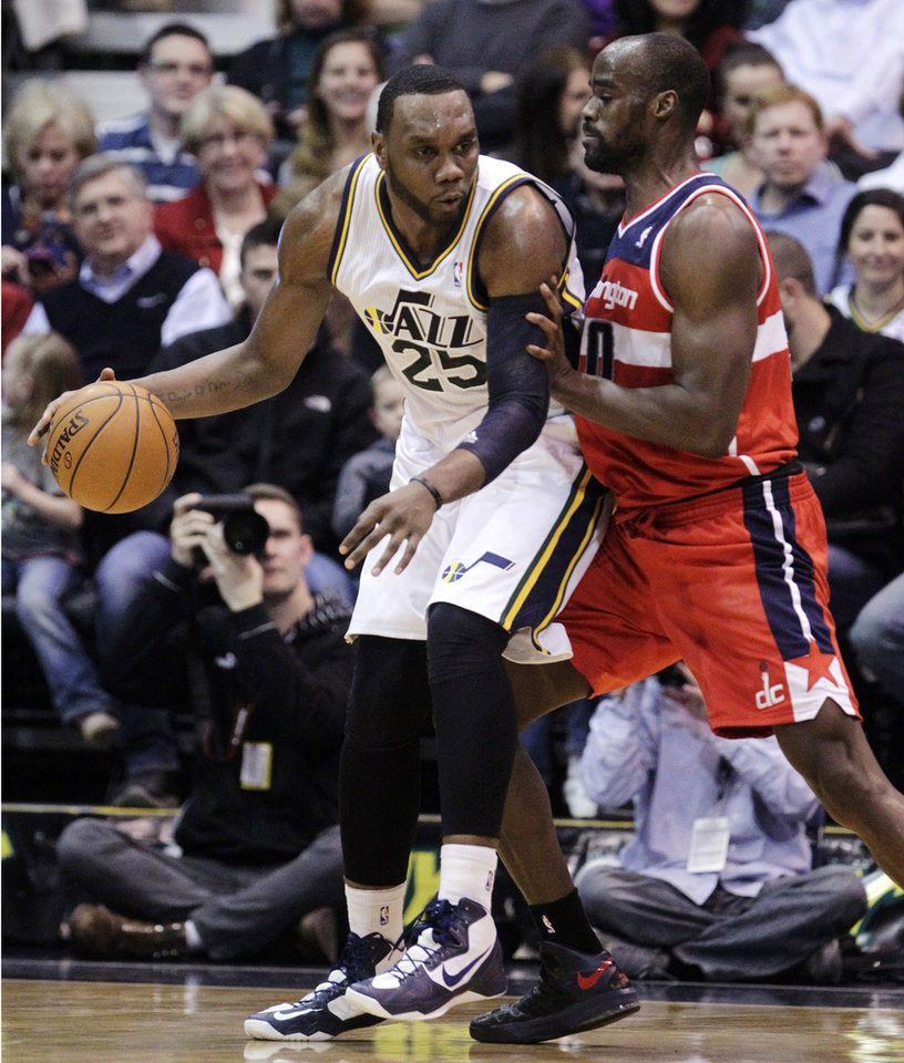 Washington Wizards' Emeka Okafor, right, defends against Utah Jazz's Al Jefferson (25) during the first quarter of their NBA basketball game, Wednesday, Jan. 23, 2013, in Salt Lake City. (AP Photo/Rick Bowmer)