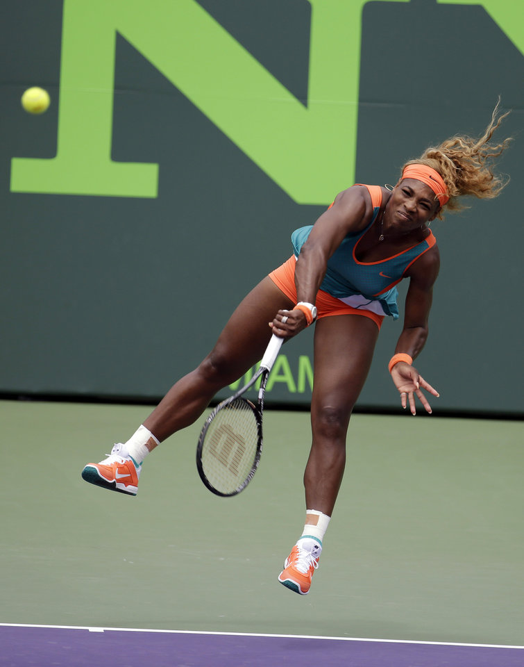 Photo - Serena Williams serves to Li Na, of China, during the women's final at the Sony Open Tennis tournament, Saturday, March 29, 2014, in Key Biscayne, Fla. (AP Photo/Lynne Sladky)