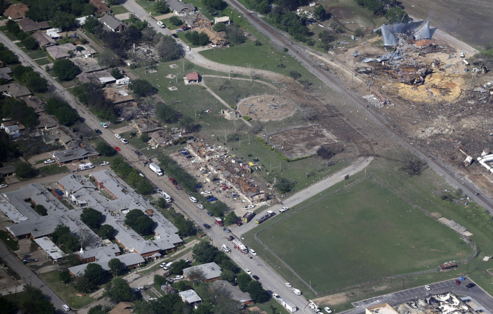 Photo - This Thursday, April 18, 2013 aerial photo shows the remains of a nursing home, left, apartment complex, center, and fertilizer plant, right, destroyed by an explosion in West, Texas. Rescuers searched the smoking remnants for survivors of Wednesday night's thunderous fertilizer plant explosion, gingerly checking smashed houses and apartments for anyone still trapped in debris while the community awaited word on the number of dead. Initial reports put the fatalities as high as 15, but later in the day, authorities backed away from any estimate and refused to elaborate. More than 160 people were hurt.  (AP Photo/Tony Gutierrez)