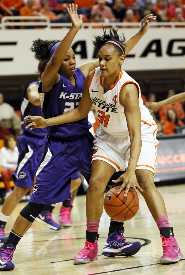 Photo - Oklahoma State's Kendra Suttles (31) works against Kansas State's Mariah White (22) during an NCAA women's basketball game between Oklahoma State University (OSU) and Kansas State at Gallagher-Iba Arena in Stillwater, Okla., Saturday, Feb. 16, 2013. Photo by Nate Billings, The Oklahoman