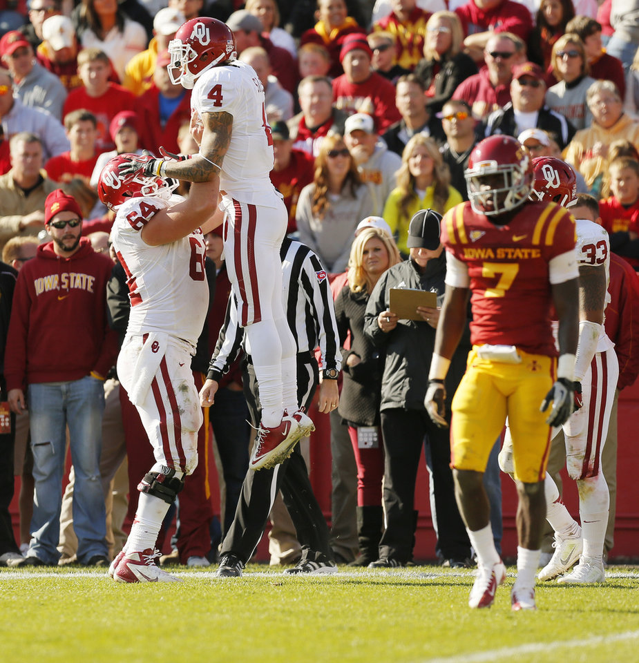 Photo - Oklahoma's Kenny Stills (4) and Gabe Ikard (64) celebrate a touchdown by Stills in the fourth quarter during a college football game between the University of Oklahoma (OU) and Iowa State University (ISU) at Jack Trice Stadium in Ames, Iowa, Saturday, Nov. 3, 2012. OU won, 35-20. Photo by Nate Billings, The Oklahoman