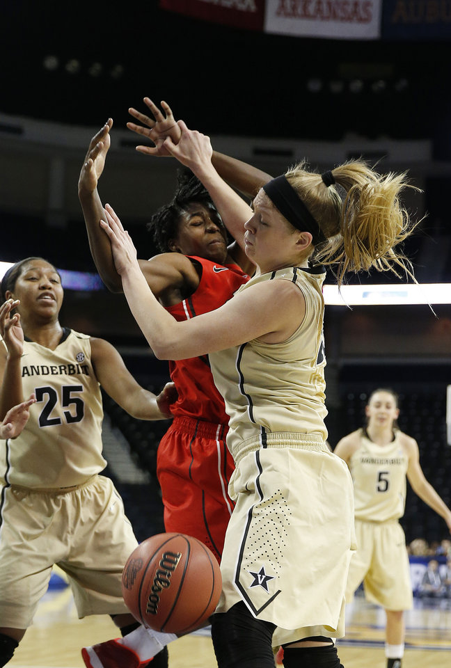 Photo - Georgia guard/forward Krista Donald (15) and Vanderbilt guard Kylee Smith (23), right, battle for a rebound in the first half of a second-round women's Southeastern Conference tournament NCAA college basketball game Thursday, March 6, 2014, in Duluth, Ga.  (AP Photo/John Bazemore)