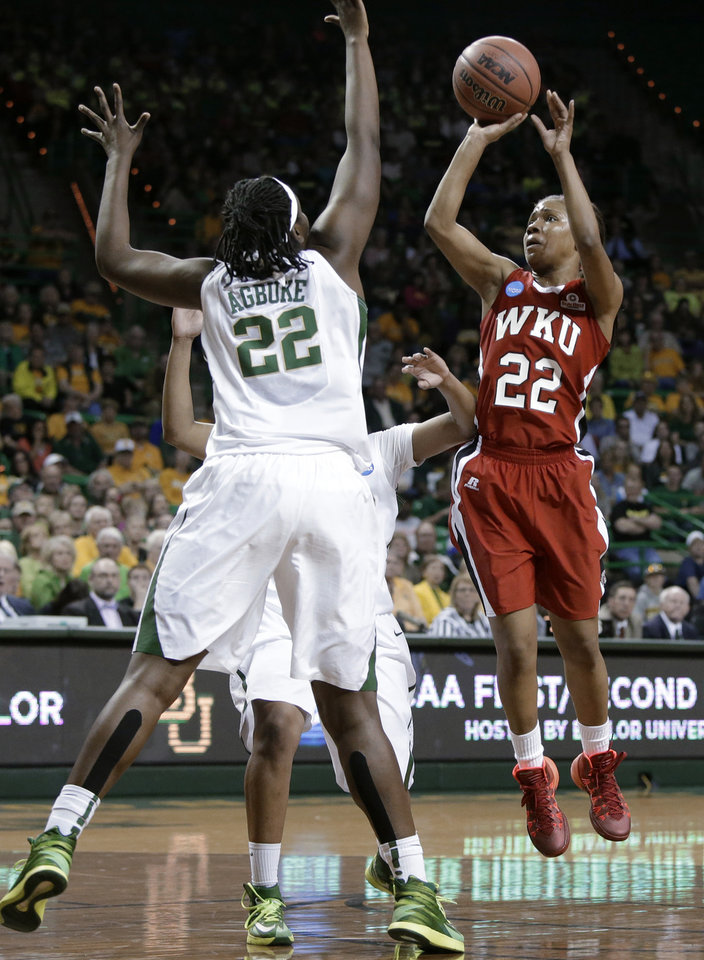 Photo - Baylor's Sune Agbuke, left, defends against a shot by Western Kentucky's Bianca McGee during the first half of a first-round game in the NCAA women's college basketball tournament, Saturday, March 22, 2014, in Waco, Texas. (AP Photo/Tony Gutierrez)