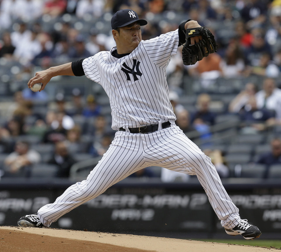 Photo - New York Yankees starting pitcher Hiroki Kuroda throws during the first inning of the first baseball game of a double-header against the Pittsburgh Pirates at Yankee Stadium, Sunday, May 18, 2014 in New York. (AP Photo/Seth Wenig)