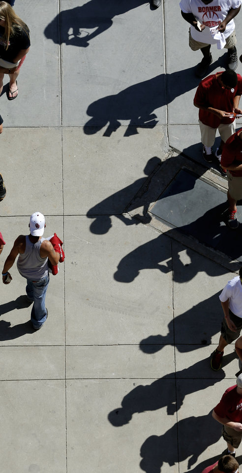 Photo - Fans hold their tickets as they wait in line before a college football game between the University of Oklahoma Sooners (OU) and the Louisiana Tech Bulldogs at Gaylord Family-Oklahoma Memorial Stadium in Norman, Okla., on Saturday, Aug. 30, 2014. Photo by Bryan Terry, The Oklahoman