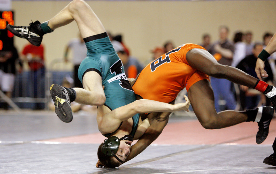 Lukas Etchison of Muskogee, left, wrestles Putnam City's Keegan Moore in a Class 6A 120-pound match of the state wrestling tournament at the State Fair Arena, Friday, Feb.24, 2012. Photo by Bryan Terry, The Oklahoman