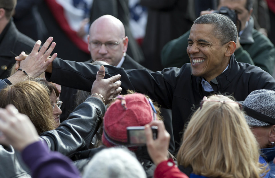 Photo -   President Barack Obama shakes hands at a campaign event in the State Capitol Square, Sunday, Nov. 4, 2012, in Concord, N.H. (AP Photo/Carolyn Kaster)