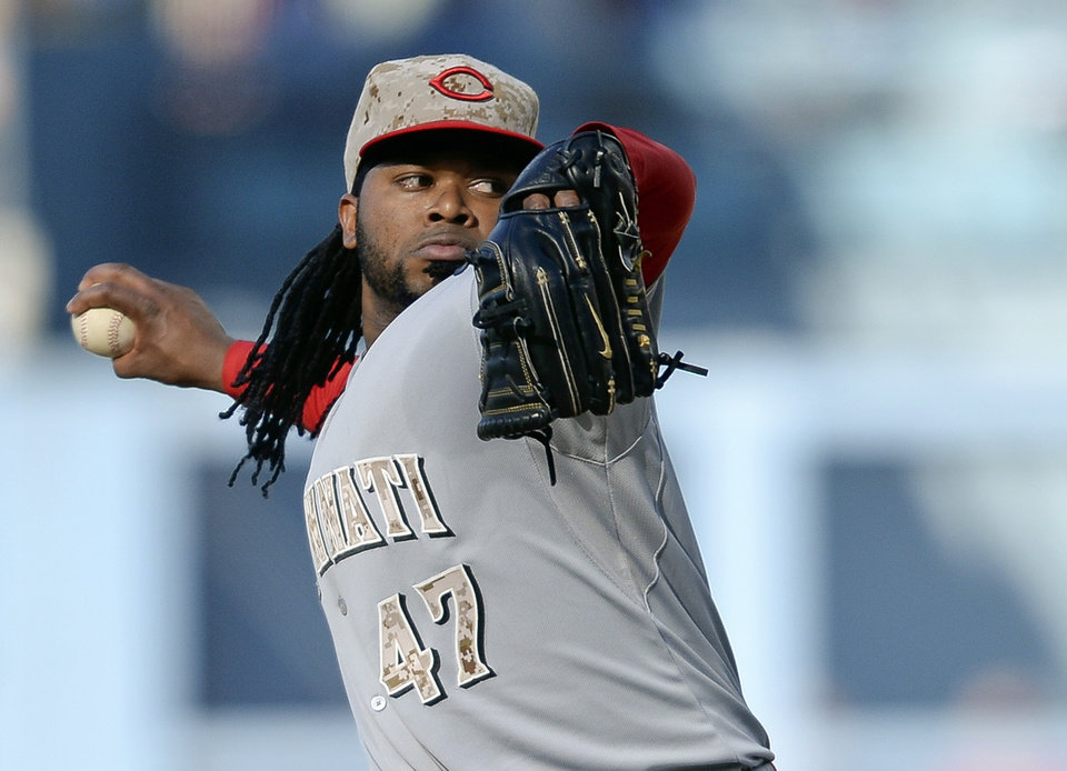 Photo - Cincinnati Reds' Johnny Cueto pitches in the first inning of a baseball game against the Los Angeles Dodgers, Monday, May 26, 2014, in Los Angeles. (AP Photo/Gus Ruelas)