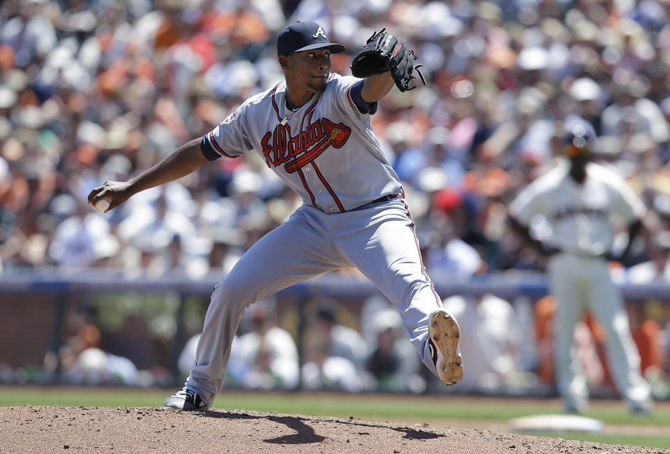 Photo - Atlanta Braves pitcher Julio Teheran throws against the San Francisco Giants during the second inning of a baseball game in San Francisco, Wednesday, May 14, 2014. (AP Photo)