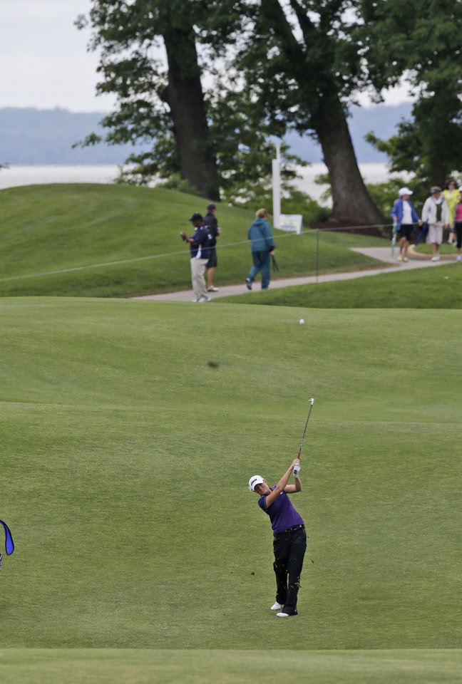 Photo - Stacy Lewis hits her second shot from the fairway on the eighth hole during the second round of the LPGA Kingsmill Championship golf tournament at the Kingsmill resort  in Williamsburg, Va., Friday, May 16, 2014. (AP Photo/Steve Helber)