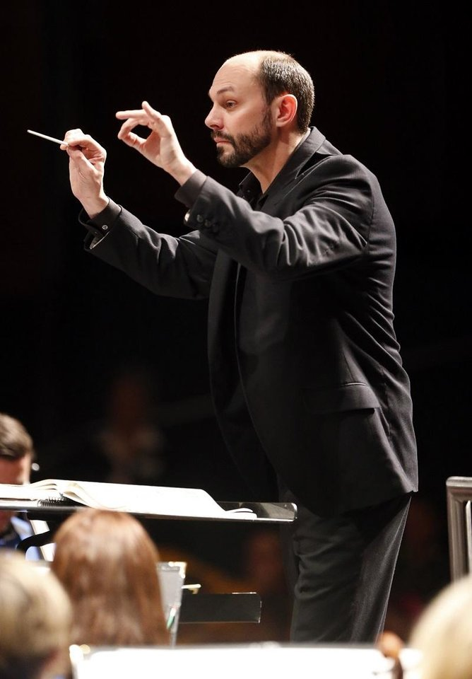 Photo - Matthew Troy conducts the Oklahoma City Philharmonic in an educational concert for schoolchildren on Wednesday, Nov. 11, 2015 in Oklahoma City, Okla. [The Oklahoman Archives]