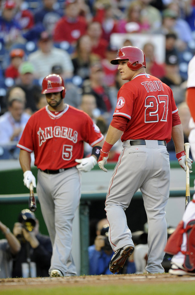 Photo - Los Angeles Angels center fielder Mike Trout (27) looks back after he struck out during the first inning of a baseball game against the Washington Nationals, Monday, April 21, 2014, in Washington. Also seen is Albert Pujols (5). (AP Photo/Nick Wass)