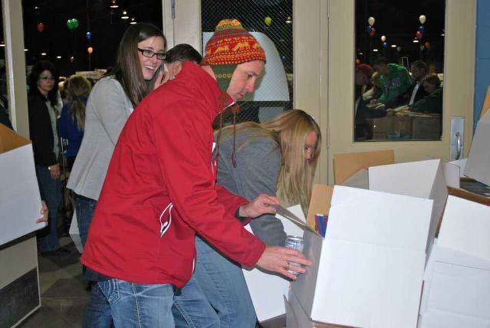 Photo - VOLUNTEERS.....Clarke Stroud helped pack up the boxes. (Photo provided).