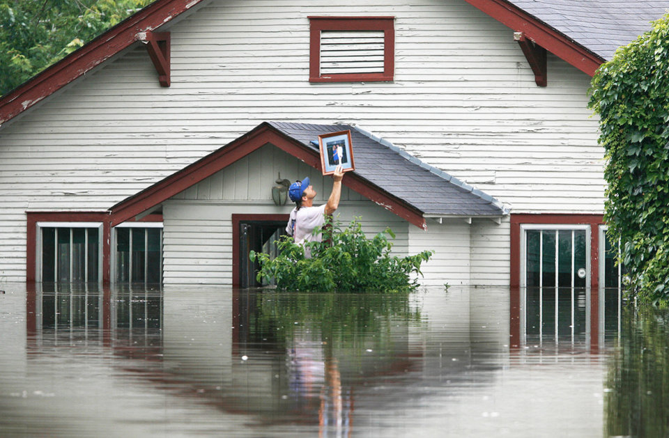 Photo - A federal report's recommendations could mean higher flood insurance rates for Oklahomans, who have been hit hard in recent years.  AP ARCHIVE PHOTO