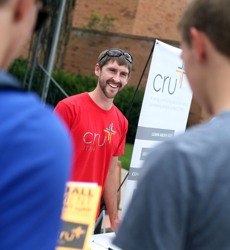 Photo -       Nate Tunnell, minister and director of Cru, center, greets new students at the University of Utah in Salt Lake City on Friday, Aug. 22, 2014. (Laura Seitz, Deseret News)
